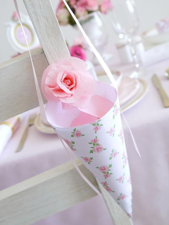 Adorn wedding reception chairs with these sweet confetti cones so guests can celebrate the bride and groom as they leave for their honeymoon.  http://www.hgtv.com/handmade/how-to-make-wedding-confetti-cones/index.html?soc=pinterest