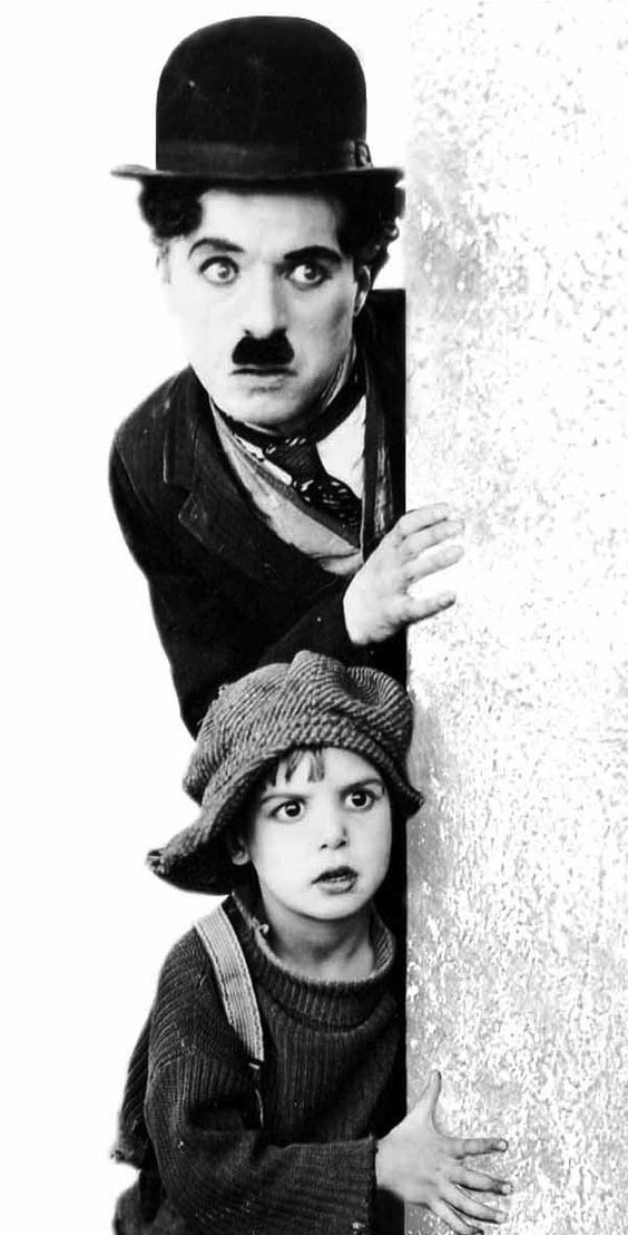 """Charlie Chaplin (April 16, 1889 - December 25, 1977) and Jackie Coogan (October 26, 1914 - March 1, 1984) in """"The Kid"""", 1921. #still"""
