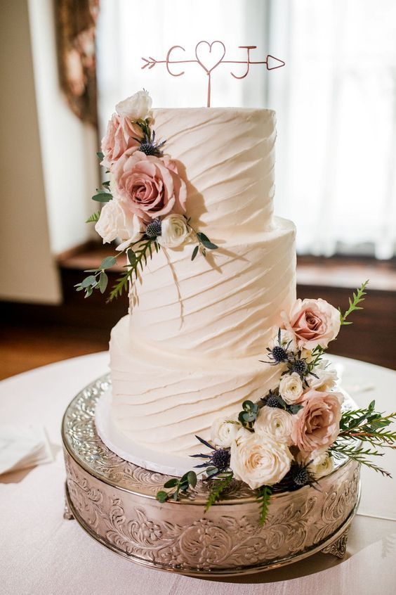 You know it is meant to be when your couple has the same initials as the venue!!! This cake is simple but stunning with it's diagonal pattern of buttercream icing. The copper cake topper is the perfect finishing touch. // More from this summer garden wedding in shades of blue, grey and blush on our blog. #rusticwedding #rusticweddingideas #rusticelegantwedding #gardenwedding #weddingcakes #weddingcakesrustic #weddingcakessimple #rusticweddingcakes