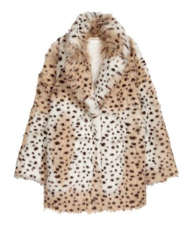 Leopard print. Jacket in soft faux fur with notched lapels, concealed snap fasteners at front, and side pockets. Lined.