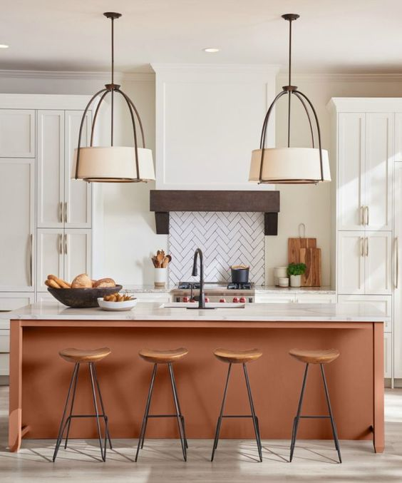 Kitchen island color is Sherwin Williams Cavern Clay. 2019 SW Color of the Year
