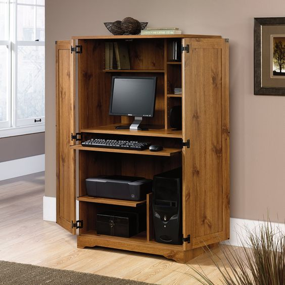 Sugar Creek Computer Armoire Spiced Pine   entertainment/computer armoire beside fireplace