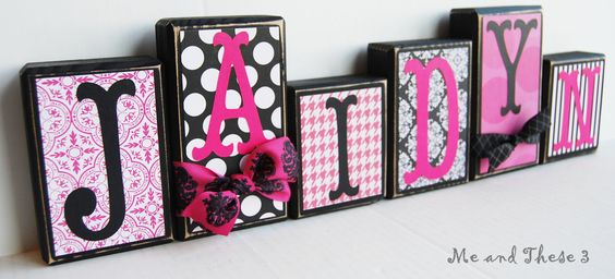 Wooden letter blocks customized with your colors and style -hot pink black white polka dot stripe houndstooth damask girl. $6.00, via Etsy.
