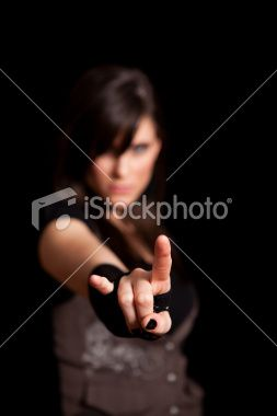 Tough Rocker Girl Making Horn Sign on Black Background Royalty Free Stock Photo
