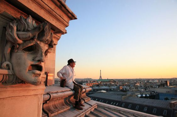 Urban beekeeper on the roof of the National Opera House in Paris, France.