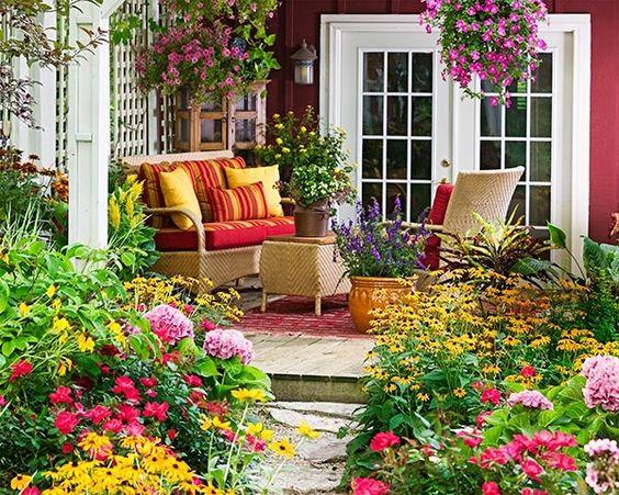 100 Gartengestaltung Bilder und inspiriеrende Ideen für Ihren Garten - gartendesign mit warmen farben steinbodenbelag gartenmöbel haus
