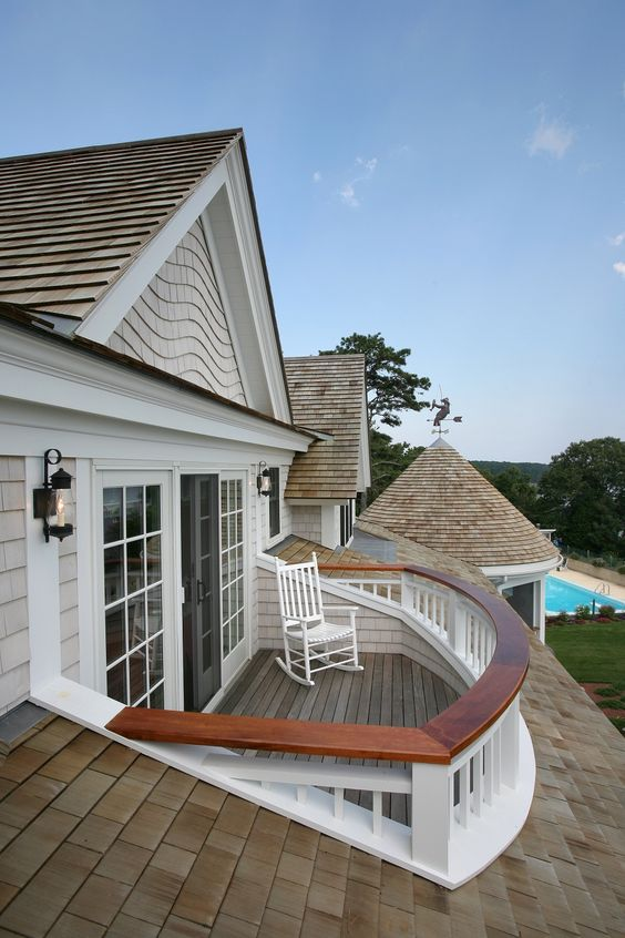 Custom shinglework encloses this beautiful second story porch on Cape Cod. Built by Cape Associates, Inc. Custom Home Builders