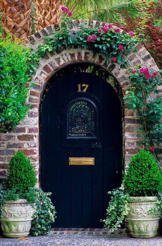 Black arched door.