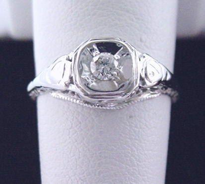 Vintage or Antique Diamond Engagement Ring 1945 Round Diamond Ring in 18K White. $265.00, via Etsy.