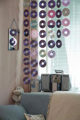 "CD curtain ("",) It would cause light to dance on the floors and the walls! I like the idea of varying heights as well...:"