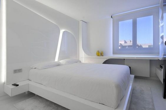 futuristic looking apartment is a duplex rehabilitation project recently completed by A-cero Architects in Galicia, Spain