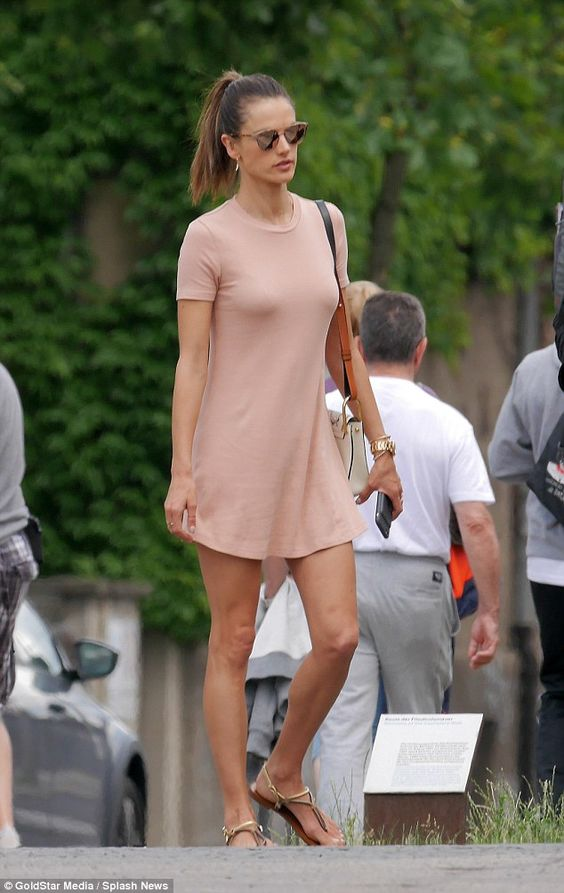 Chic comfort: Clearly not a fan of plain jeans, a t-shirt and comfortable walking shoes, Alessandra revealed her tourist style to be something worthy of a catwalk