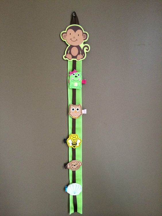 Monkey see, monkey do! This cute bow and clip holder is the perfect addition to any room. On sale now at www.littleheartz.com #littleheartz #hairbows #monkeyseemonkeydo