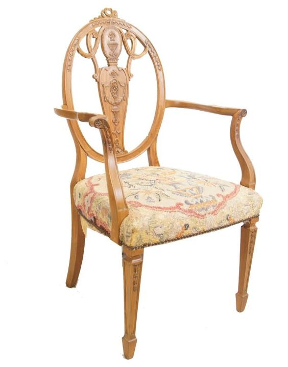 A set of seven including two arm chairs, each with tapering square section front legs, the back-splat pierced with rosettes, swags and urns and with ribbon cresting with tapestry seats, late 19th century Provenance: Santa Barbara, Ca Collection via Blondeau Raoul: French Consulate to China 1910-1939