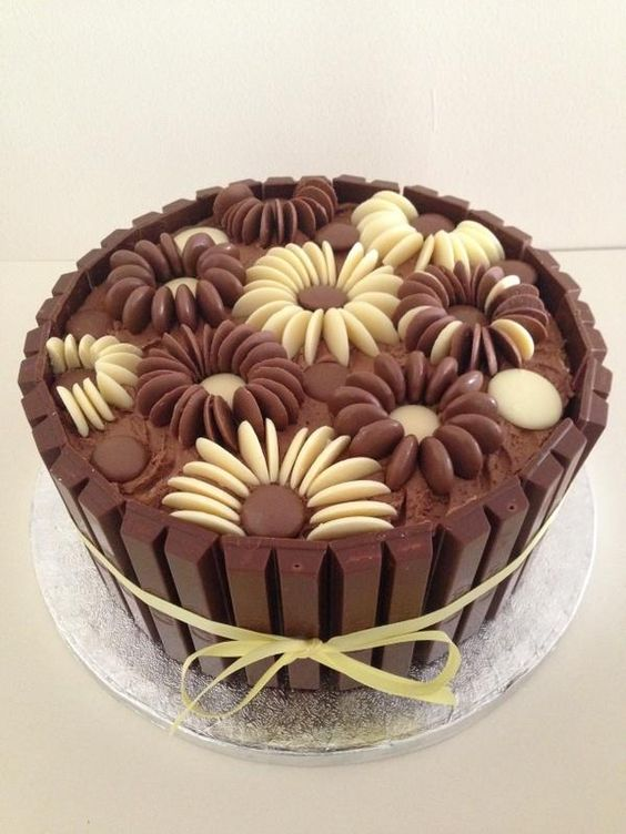 Chocolate Flowers Cake Decoration Telegraph : A simple but very effective cake, using chocolate buttons ...