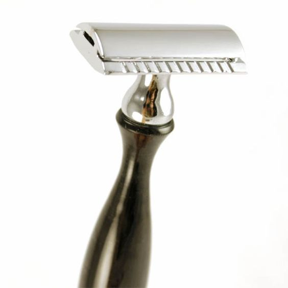 Chrome and water buffalo horn safety razor.