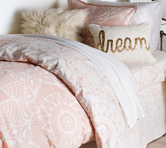 And pink and white comforter for a twin size bed.