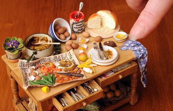 A tiny kitchen table laden with detailed food made by Charlotte and Martin Willmott