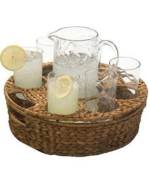 Serve drinks with ease, indoors or out. Our eight-piece Garden Terrace Serving Set includes six glasses and a pitcher, securely set in a deep seagrass tray.