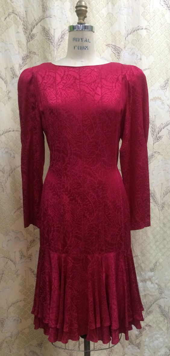 Long sleeve, red cocktail Dress made by Argenti. Label lists it as size 13…