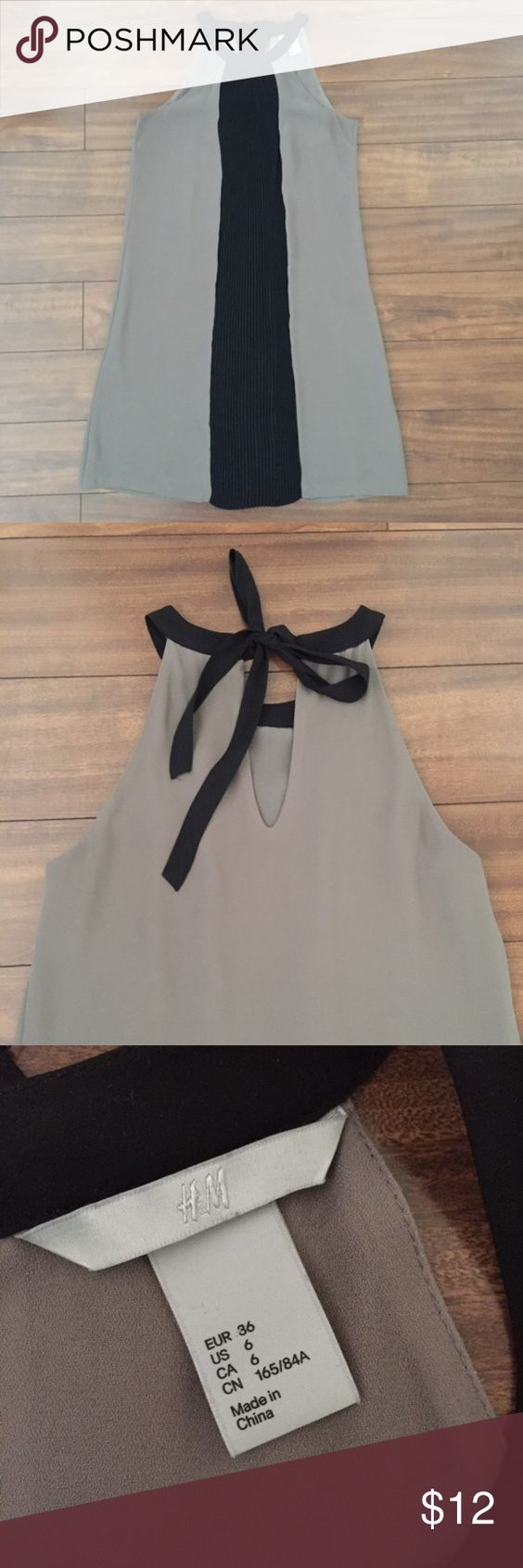 H&M Dress Grey and black dress. Ties in the back. Loose fit, hits above knees. It's size 6 but fits like an S. H&M Dresses