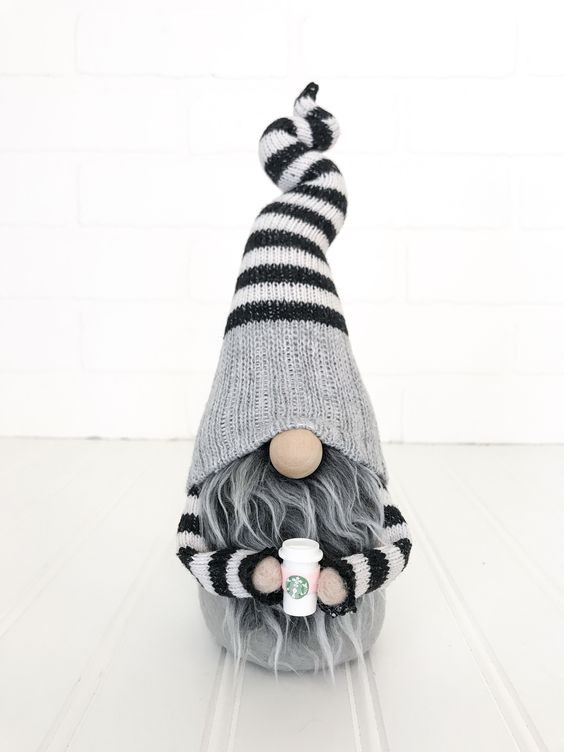 Black and white gnome with grey curly beard. Adorable addition to any and all homes!