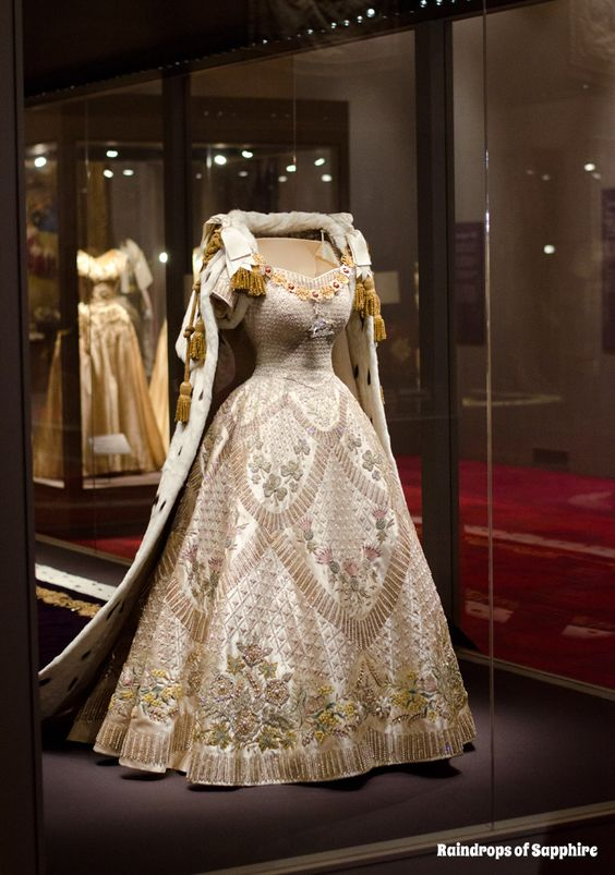 Queen Elizabeth II's Coronation Dress, designed by Norman Hartnell and Coronation Robe made by Ede and Ravenscroft and embroidered by the Royal School of Needlework, 1953.