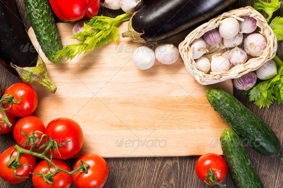 vegetables on the kitchen board ...  agriculture, background, board, border, bright, center, color, colorful, cook, cooking, copy, cucumber, cuisine, cutting, design, diet, different, eating, edges, eggplant, food, frame, fresh, freshness, garlic, green, health, healthy, herb, ingredient, kitchen, natural, open, orange, organic, paprika, pepper, red, restaurant, space, spice, summer, table, tomato, vegetable, vegetarian, white, wood, wooden, yellow