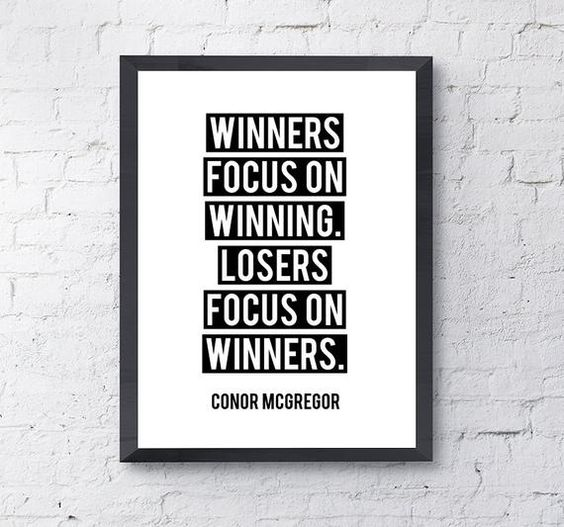 """Winners Focus On Winning. Losers Focus On Winners""Choose from two types of paper weight:- Matte Paper - High-Quality, white, ultra smooth matte paper OR- Archival Matte Paper - 100% cotton rag, natural white, acid-free archival paper. Known to last about 100 years without discoloring if kept out of direct sunlight and behind glass.Regardless of paper weight, prints are printed using archival inks to preserve the colors, quality, and life of the art.Please note that the background is not part of"