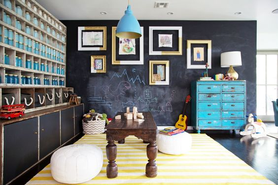 You'll Envy This Effortlessly Cool Family Home // white Moroccan poufs, blue pendant, worn blue dresser, gold table lamp
