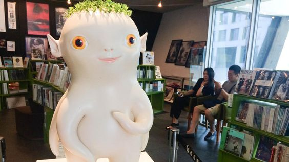 A figurine of Wuba, the radish-like central character in 'Monster Hunt' in the lobby of a Beijing theater.  A monster resembling a radish shatters a box office record in China