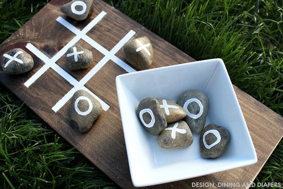 DIY Ideas | This tic-tac-toe board made from a piece of scrap wood and rocks is perfect for keeping outside for summer BBQs and get-togethers!:
