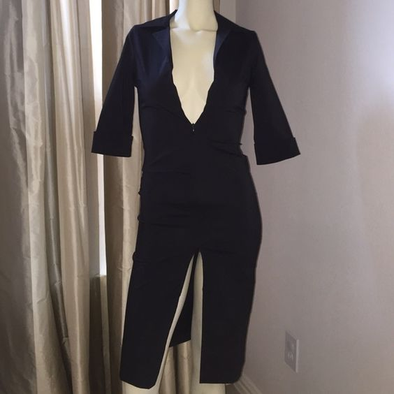 Black zip up dress. 3/4 length sleeves. This dress is form fitting. The seam in the slit is coming undone. Needs sewn. Dresses