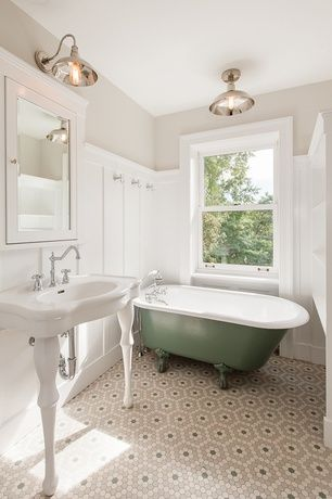 Traditional Full Bathroom with Flush, flush light, penny tile floors, Wainscotting, Clawfoot, Console sink, Glass panel