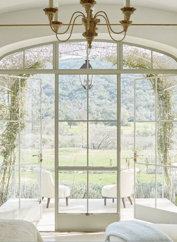 French country and French farmhouse interior design inspiration from a modern farmhouse (Patina Farm). Dreamy serenity of an arched steel trellis embraced with reed vine fencing. #frenchfarmhouse #frenchcountry #archedwindow #interiordesign #romantic