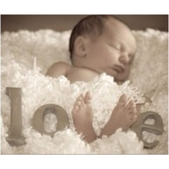 No site, just a cute idea for a newborn shot. Again, would be cute to incorporate the kids in with the baby.: