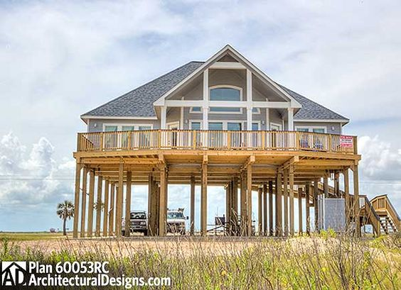 Beach homes home plans and house plans on pinterest for Narrow house plans with garage underneath