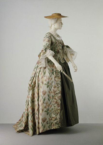 Sack back gown    Place of origin:  France (woven)   UK (made)    Date:  ca. 1760 (made)    Artist/Maker:  unknown (production)    Materials and Techniques:  Chine woven silk, lined with linen, trimmed with fly fringe, hand-sewn