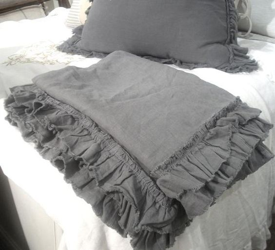 A fleece (?) blanket/throw with ruffled edges would not be hard to make and a bit less ordinary.