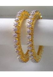 Garish Golden Color Metal with White Stone Studded Bangles