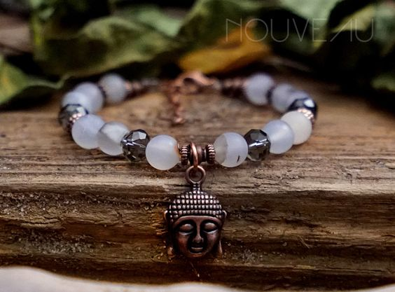 A personal favorite from my Etsy shop https://www.etsy.com/listing/467242078/buddha-charm-bracelet-with-botswana