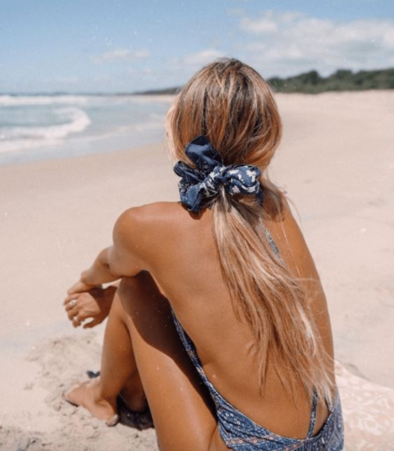 messy ponytail with a scarf on the beach