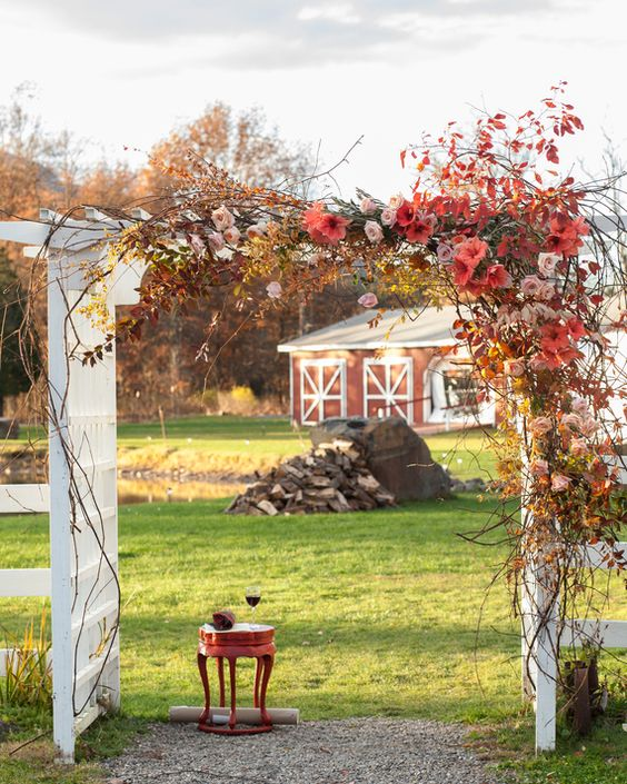 An existing white arbor at Kaaterskill Farm doubled as a chuppah for Hanna and Jimm's upstate New York ceremony in November. Their florist, Saipua, wrapped it in branches, roses, and persimmons that played up the season's rich colors.