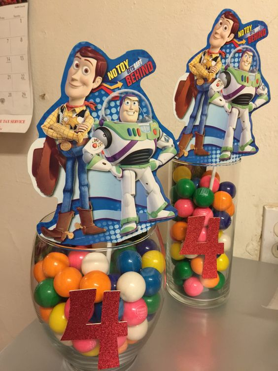 Centerpieces for my daughter's birthday. Glass vase filled with gumballs.
