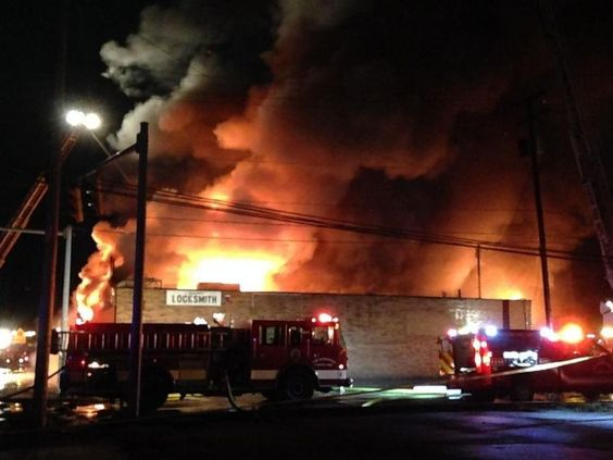 Firefighters battled for hours tonight a blaze that injured a man at a business on the southwest side of Dueber Avenue and Navarre Road SW.
