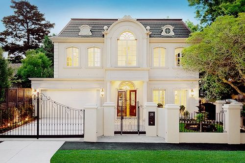 Iron gates front doors and dormer windows on pinterest - Houses with arched windows ...