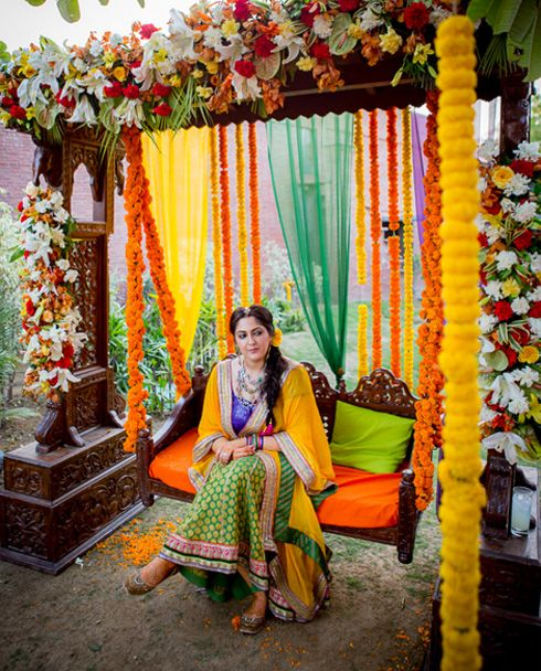 Mehndi Jhoola Decoration : A beautiful jhula adorned with flowers would be perfect