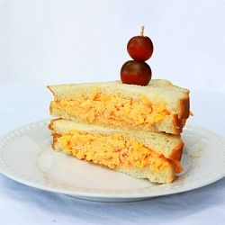 "Pimento Cheese Sandwich - The Southern iconic food is knows as ""pimmenocheese"" as if it's one word."
