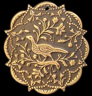 Bird in Tapestry Brass Stamping. This piece reminds me of an ancient tapestry I once saw so goes the name. This finding is a nice weight and size for a pendant. You can also order it with a nice verdigris finish. It measures 40mm.