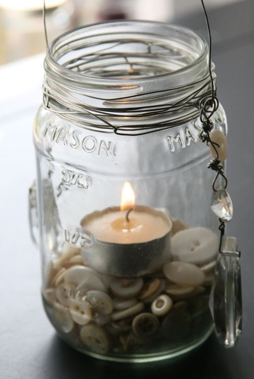 Mason Jar Lantern Tutorial    Easy to make...use sand, pebbles, shells...whatever suits your style, for fill...then trim with beads, bells, etc.